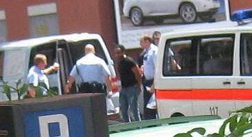 zurich metro squaq cops arrest black man on a sunday afternoon in june 2009. everyday scene in this town.