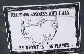 ALL THIS SADNESS AND HATE. MY HEART IS IN FLAMES. street art sticker zurich switzerland 2010