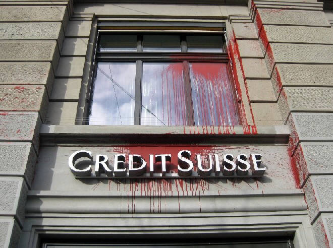 color bomb attack against swiss bank CREDIT SUISSE bank in zurich switzerland attacked with color bombs in january 2013. farbanschlag auf CREDITS SUISSE bankfiliale in zürich im januar 2013